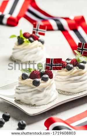 Norwegian national day 17th May. Mini Pavlova cake with flag. Norwegian flag Stock photo ©
