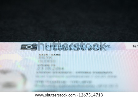 Norwegian residence permit on a black background with a copyspace on top (text translation: