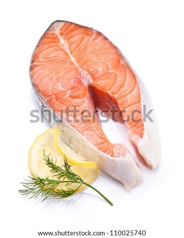 Norwegian salmon red fish on white plate - stock photo