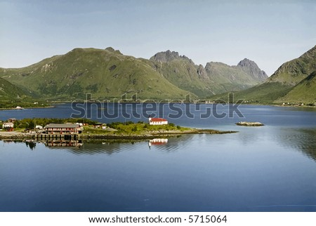 Norwegian village, fjord and mountain landscape. bay and a island.