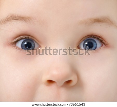 Nose and two eyes of child - face close up