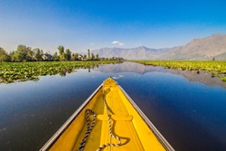 Nose of the wooden boat on the water of Dal lake in Srinagar, Kashmir, India