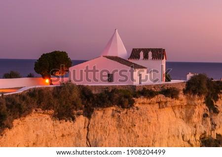 Nossa Senhora da rocha (Our lady of the rock) on the top of the cliff , Armação de Pera Algarve Portugal  Foto stock ©