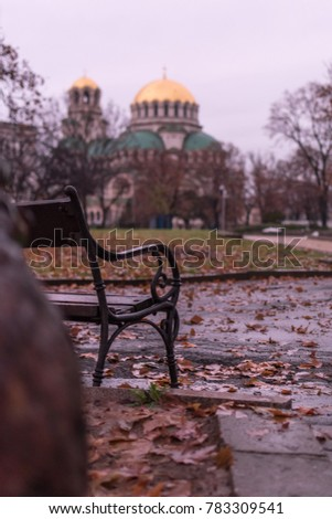Nostalgic autumn view with a benach and the Alexander Nevsky Orthodox Christian Cathedral in Sofia, Bulgaria, in the background