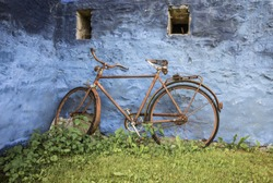 Nostalgic bike on the wall of a old farmhouse.