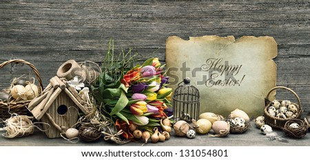 nostalgic easter decoration with eggs and tulip flowers. vintage style still life. home interior