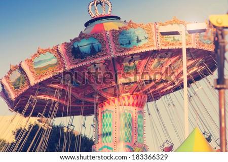 Nostalgic street fair ride in subtle vintage tones