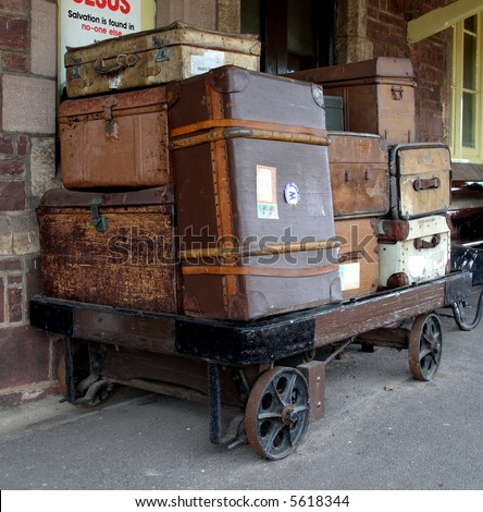 Nostalgic view of old Luggage and Baggage on a Platform Trolley at a Train Station in England