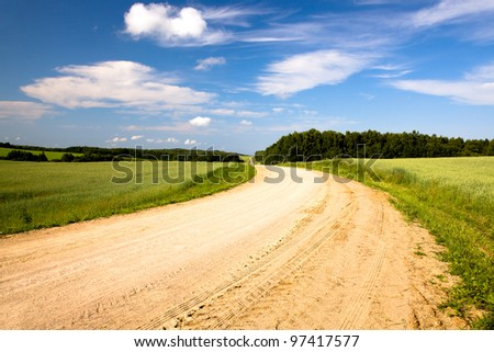 not asphalted rural rural road to summertime of year. Belarus