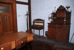 Not focus and noise image, an ancient house with worn furniture made of broken wood