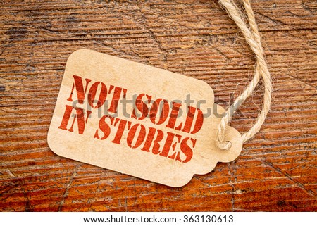 not sold in stores marketing slogan - red stencil text on a paper price tag against rustic wood #363130613