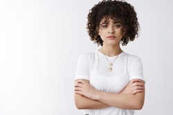 Not your toy. Serious-looking determined assertive good-looking stylish curly hairstyle female cross arms chest confident look camera ready, aim success, believe girl power, white background