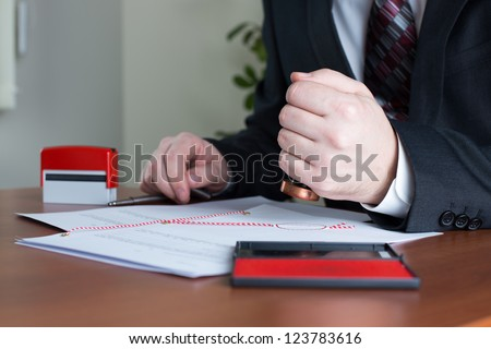Notary Public stamping a certified copy in his office