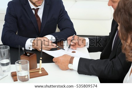 Notary with client in office #535809574