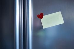 note at refridgerator with heart sticker to send the message in the kitchen