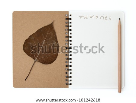 Note book diary with pencil and old leaf
