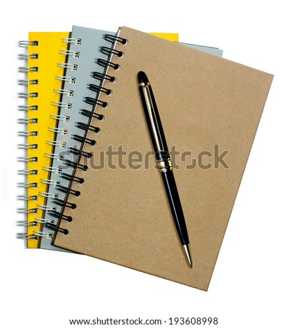 note book,Top view of a note book with a pen on white background.