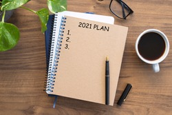 Note book with 2021 goals text on it to apply new year resolutions and plan.