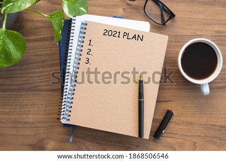 Note book with 2021 goals text on it to apply new year resolutions and plan. Photo stock ©
