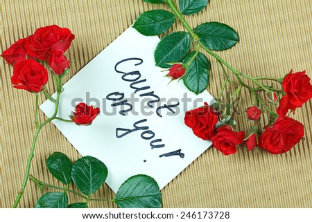 Note Count on you,  written on white paper and framed with roses.