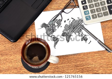 Note map world on table businessman