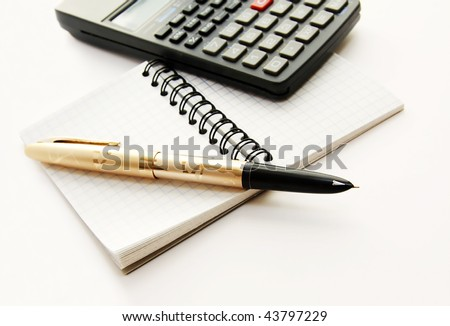 Note notepad in a cage, a pen pen and the countable machine on a white background