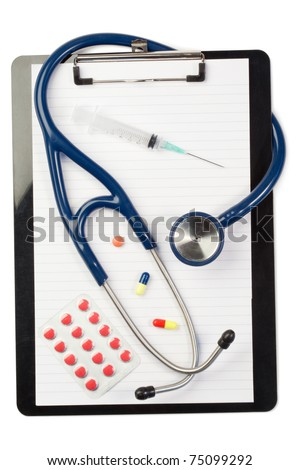 Note pad and stethoscope with color capsules and blister strip on a white background