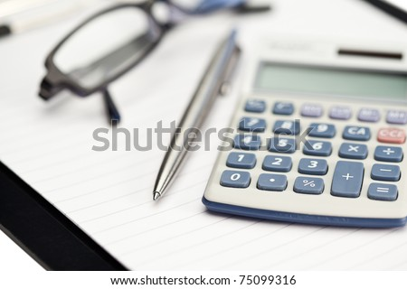 Note pad, pen, glasses and pocket calculator on a white background