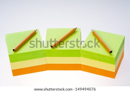 Note pads of paper and pencils