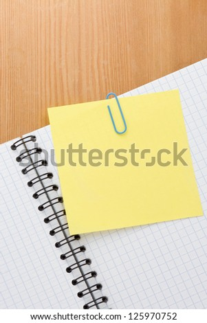 note paper and checked pad on wood background