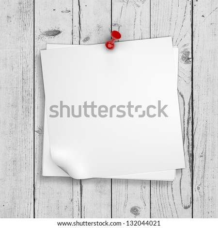 note paper pinned on white wooden wall