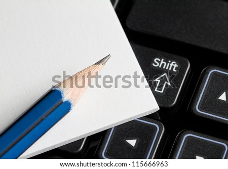 Note Paper with a pencil on a computer.