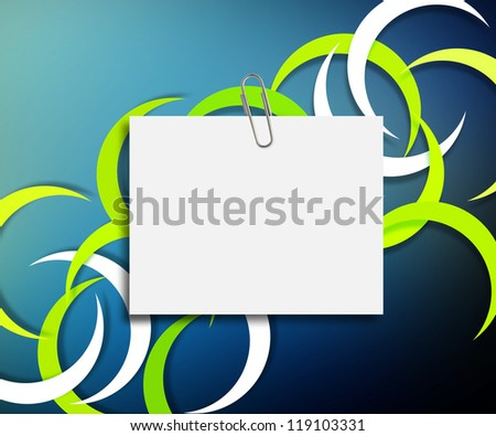 note paper with paper clip on colorful background.