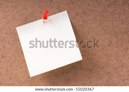 Note paper with push pins on noticeboard