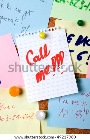 "Note saying ""call me"" pinned on cork notice board"