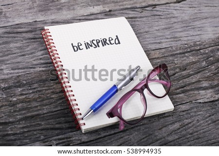 Note with be inspired on the wooden background #538994935