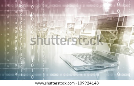 Notebook against colour background with various images