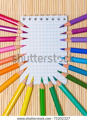 Notebook and color pencils.  An empty place for your text.