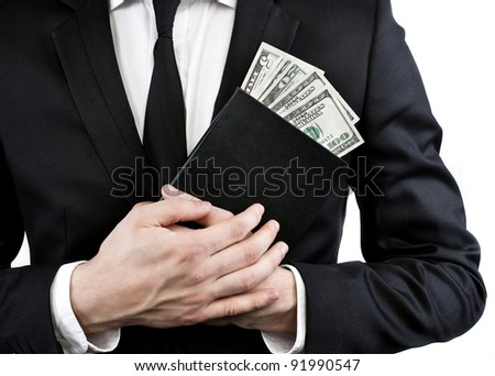 Notebook and money in the hands of a man in a jacket and tie