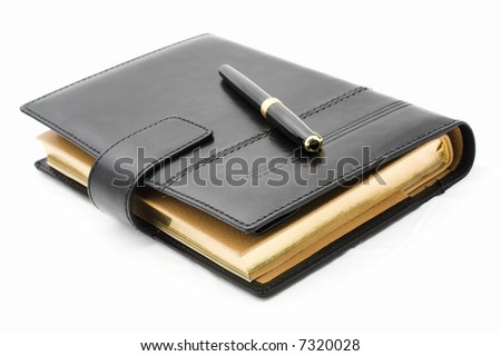 Notebook and pen  isolated on a white background