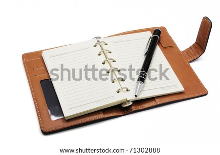 Notebook and pen isolated on white background