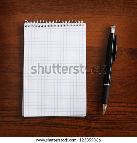 notebook and pen on a table