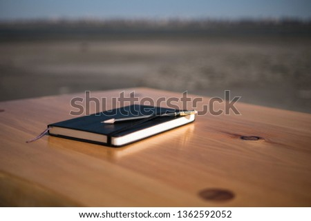 Notebook and pencil on the loft table. loft furniture