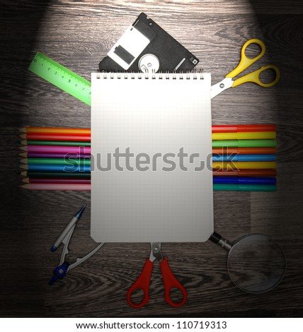 Notebook and school tools. On a wooden background.