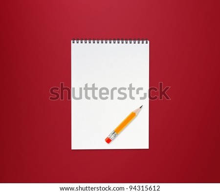 Notebook and small yellow pencil with eraser on red background