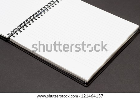 Notebook background in lines open view with  a spiral binding