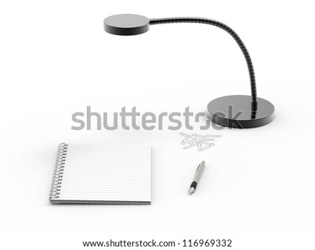 Notebook , ballpoint pen and paperclips on office desk