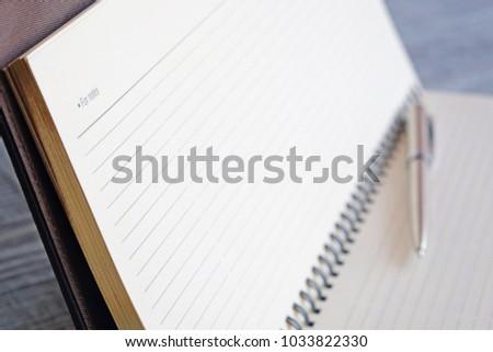 Notebook calendar and pen. Selected focus #1033822330