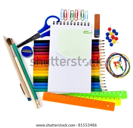 Notebook , colored pencils, back to school concept frame with copy space over white background