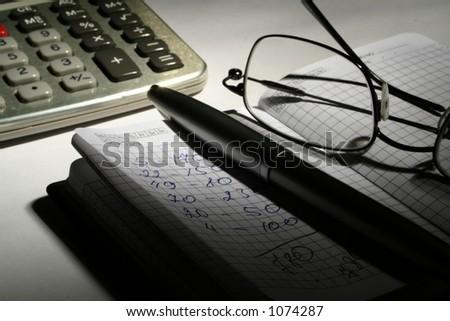 Notebook glasses calculator pen